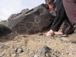 I'm looking closely at the Quail petroglyph.
